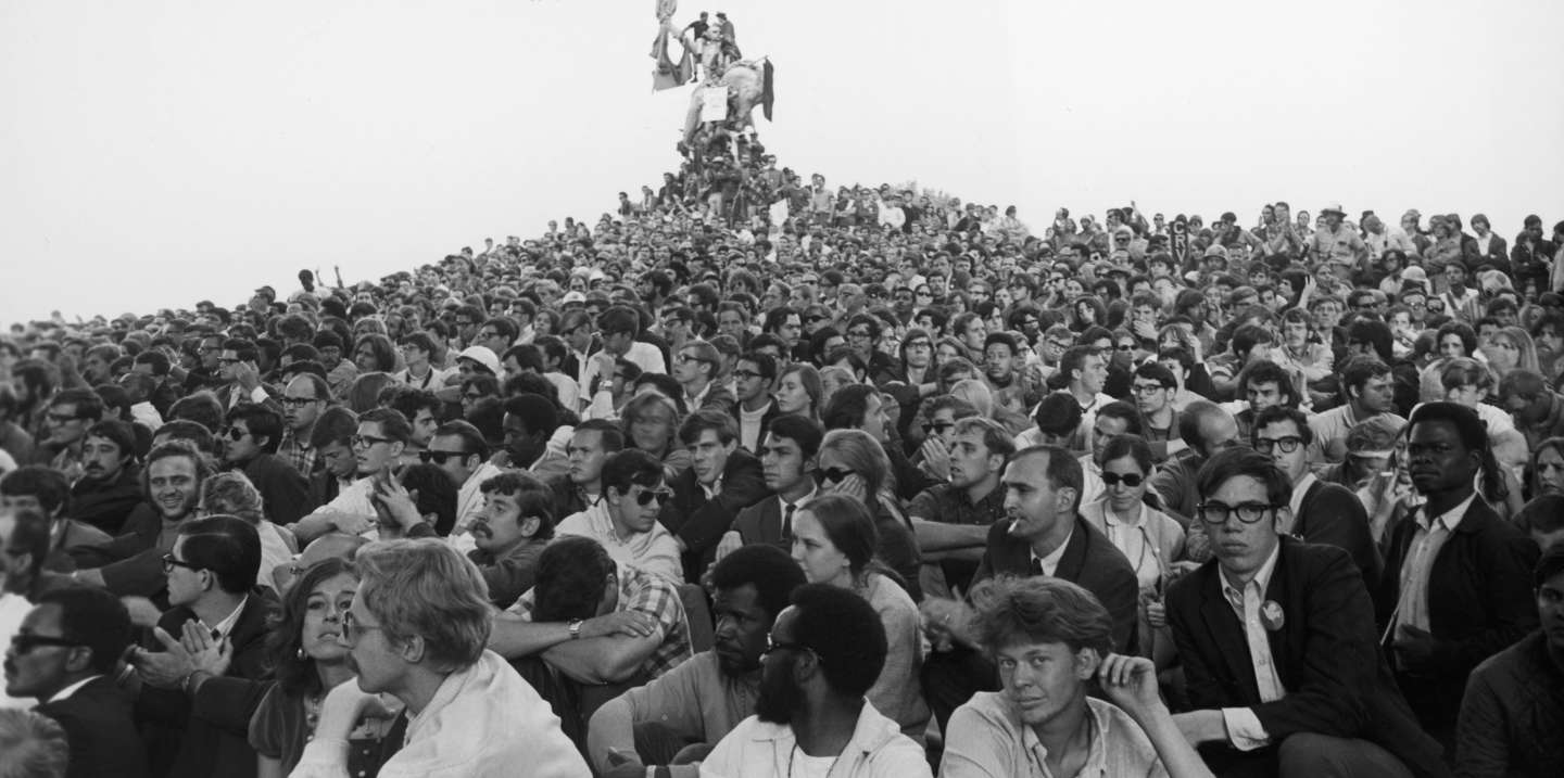 View of an enormous crowd of demonstrators as they sit on a hill that leads up to a statue of Union General John A. Logan astride a horse in Grant Park during protests at Democratic National Convention, Chicago, Illinois, August 27, 1968. (Photo by Fred W. McDarrah/Getty Images)