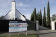 Un panneau montrant une maison à vendre, le 13 août, à Christchurch, sur l'île du Sud, en Nouvelle-Zélande.