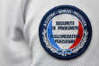 A shoulder patch reading 'Local Security - Parisian Agglomeration' is pictured on the uniform of a French police woman at the Prefecture of Bobigny, near Paris, on May 29, 2018. / AFP PHOTO / GERARD JULIEN