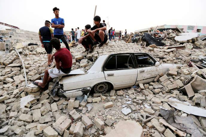 Après l'explosion d'une bombe, à Bagdad, le 7 juin.