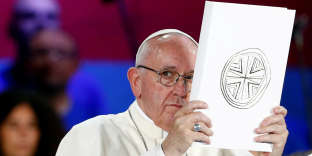 FILE PHOTO: Pope Francis holds the Book of the Gospels as he meets Italian youth at the ancient Circo Massimo in Rome, Italy August 11, 2018. REUTERS/Max Rossi/File Photo