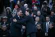 """(FILES) In this file photo taken on April 29, 2018 Canadian Prime Minister Justin Trudeau(R) shakes hands with the leader of the Conservative Party of Canada, Andrew Scheer, as they attend a vigil for the victims of a van attack in Toronto that left 10 dead, in Toronto, Canada. Canada's opposition leader will travel to India to """"repair"""" bilateral ties he said were harmed by Prime Minister Justin Trudeau, who was dogged by controversies on his first official trip there earlier this year. Tory leader Andrew Scheer said he would meet this fall with Indian officials as well as business, civil society and religious leaders, likely in a bid to shore up support among Canada's large Indian diaspora ahead of next year's general election. / AFP / GETTY IMAGES NORTH AMERICA / Cole Burston"""