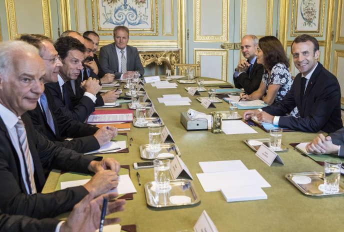 Le président français, Emmanuel Macron, lors d'une réunion avec les partenaires sociaux à l'Elysée, le 17 juillet 2018.