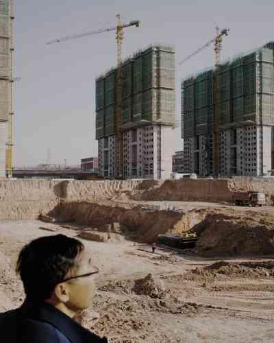 Construction d'un immeuble d'habitations à Lanzhou. Lesautorités chinoises espèrent que la métropole abritera un million de résidents d'ici à2030.