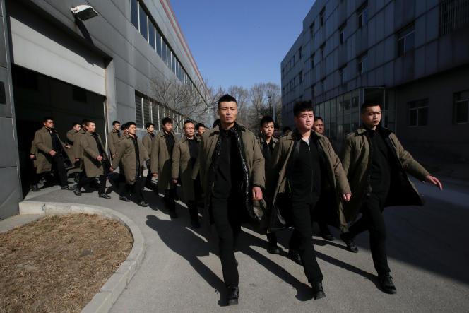 Des membres de la compagnie de sécurité chinoise Dewei Security à l'entraînement, à Pékin, en mars 2017.