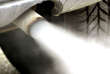 FILE -- In this Tuesday, Jan. 27, 2004 file photo exhaust gases leave the exhaust pipe of a car in Frankfurt, Germany. (AP Photo/Michael Probst, file)