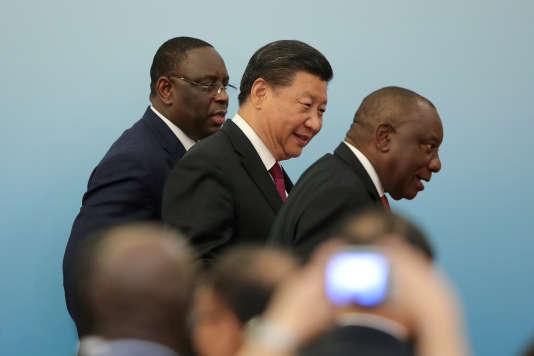Xi Jinping avec le président de l'Afrique du Sud Cyril Ramaphosa et du Sénégal, Macky Sall, lors du Sommet sur la coopération Chine-Afrique, à Pékin, le 4 septembre 2018.