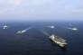 Le porte-avions chinois« Liaoning», entouré d'autres navires militaires, en mer de Chine orientale, en avril 2018.