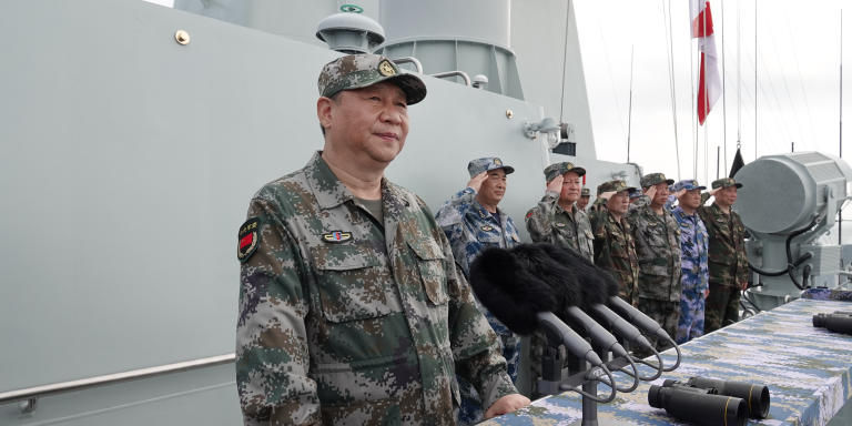 (180412) -- SANYA, April 12, 2018 (Xinhua) -- Chinese President Xi Jinping, also general secretary of the Communist Party of China Central Committee and chairman of the Central Military Commission, reviews the Chinese People's Liberation Army (PLA) Navy in the South China Sea on April 12, 2018. Xi made a speech after the review. (Xinhua/Li Gang) (zkr)