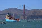 "A ship tows The Ocean Cleanup's first buoyant trash-collecting device toward the Golden Gate Bridge in San Francisco en route to the Pacific Ocean on Saturday, Sept. 8, 2018. Once deployed, the boom will form a U-shaped barrier to trap plastic and trash that currently makes up the ""Great Pacific Garbage Patch."" (AP Photo/Lorin Eleni Gill)"