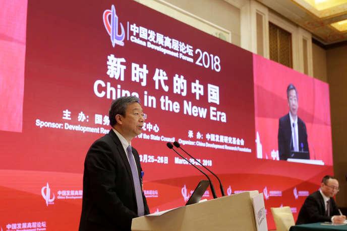 Yi Gang, gouverneur de la Banque centrale de Chine, à Pékin, le 25 mars. La Chine a contribué pour un tiers à la flambée mondiale de la dette.