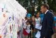 France's President Emmanuel Macron looks at a wall with children's drawings during the 35th edition of France's heritage open days, at the Elysee Palace, in Paris, Saturday, Sept. 15, 2018. The national buildings and administrations of France are open to the public for the Heritage Days weekend. (Anne Christine Poujoulat/ Pool photo via AP)