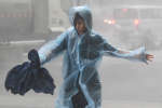 A woman runs in the rainstorm as Typhoon Mangkhut approaches, in Shenzhen, China September 16, 2018. REUTERS/Jason Lee  TPX IMAGES OF THE DAY