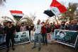 Des manifestants à Bassora défilent avec les portraits de personnes tuées lors de précédentes marches, le 12 septembre.