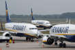FILE PHOTO: A Ryanair airplane taxis past two parked aircraft at Weeze Airport, near the German-Dutch border, during a strike of Ryanair airline crews, protesting the slow progress in negotiating a collective labour agreement in Weeze, Germany, September 12, 2018. REUTERS/Wolfgang Rattay/File Photo