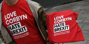 T-shirts promoting a pro-Corbyn, anti-Brexit stance is seen on sale outside the Labour Party Conference in Liverpool, north west England on September 23, 2018, the official opening day of the annual Labour Party Conference. Britain's Labour Party kicks off its annual conference on Sunday hoping to prove it is ready to unseat the embattled Conservative government despite its own splits on Brexit and rows over anti-Semitism. / AFP / Paul ELLIS