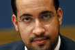FILE - In this Sept.19, 2018 file photo, former President Macron's security aide Alexandre Benalla appears before the French Senate Laws Commission prior to his hearing, in Paris, France. A French investigative website has published photos of Benalla posing with a gun in a fun photo with a waitress during a campaign stop weeks ahead of the May 2017 election — without any known authorization to be armed. (AP Photo/Thibault Camus, File)