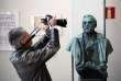 A man takes a picture of a statue of Swedish inventor and scholar Alfred Nobel prior to a press conference at the Karolinska Institute in Stockholm, Sweden, on October 1, 2018. / AFP / Jonathan NACKSTRAND
