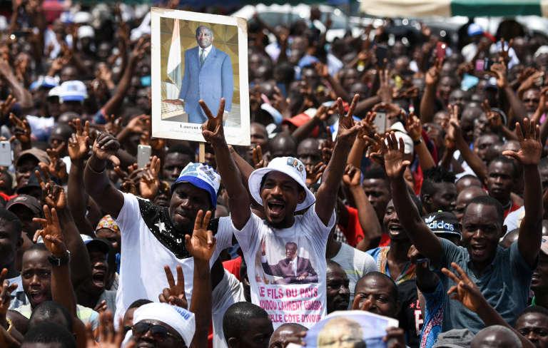Pendant un rassemblement de la coalition Ensemble pour la démocratie et la souveraineté, favorable à l'ancien présidentivoirien Laurent Gbagbo, le 28juillet 2018 à Yopougon, un quartierd'Abidjan.
