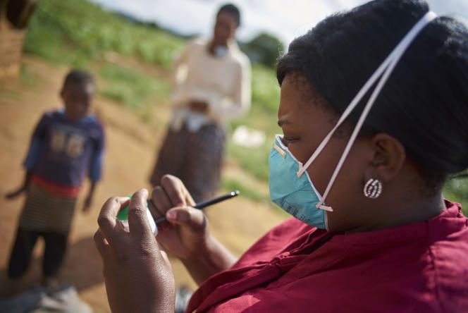 Consented, but Identities to be protected.  During a home visit, Faith Slamini (red shirt), Cough Monitor from at the TB Clinic in Baylor Tuberculosis Centre of Excellence, collects sputum samples from a family in a village about 10 km out of Mbabane, Swaziland.