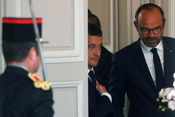 Le ministre de l'action et des comptes publics Gérald Darmanin et le premier ministre Edouard Philippe, à l'Elysée, le 3 octobre.