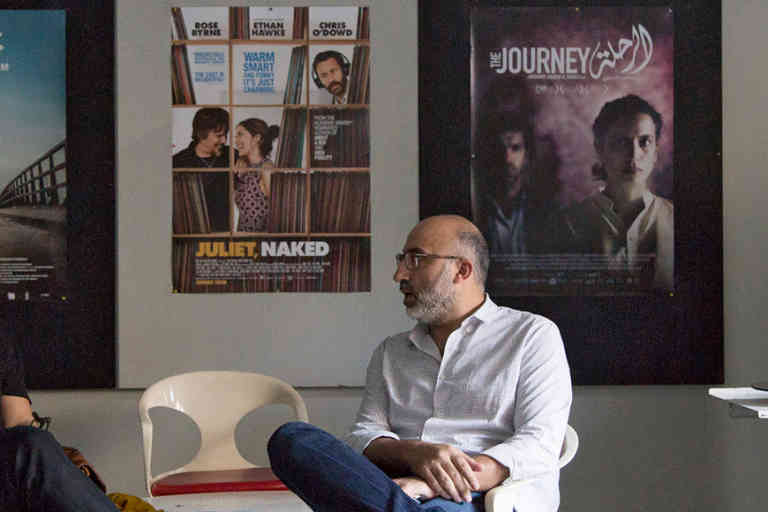 Lebanese film producer Georges Schoucair, of Abbout Productions, left, and film maker Ahmad Ghossein sit at the Metropolis Art Cinema in Beirut, Lebanon.