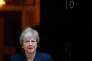 Theresa May quitte le 10 Downing Street pour se rendre au Parlement, à Londres, le 10 octobre.