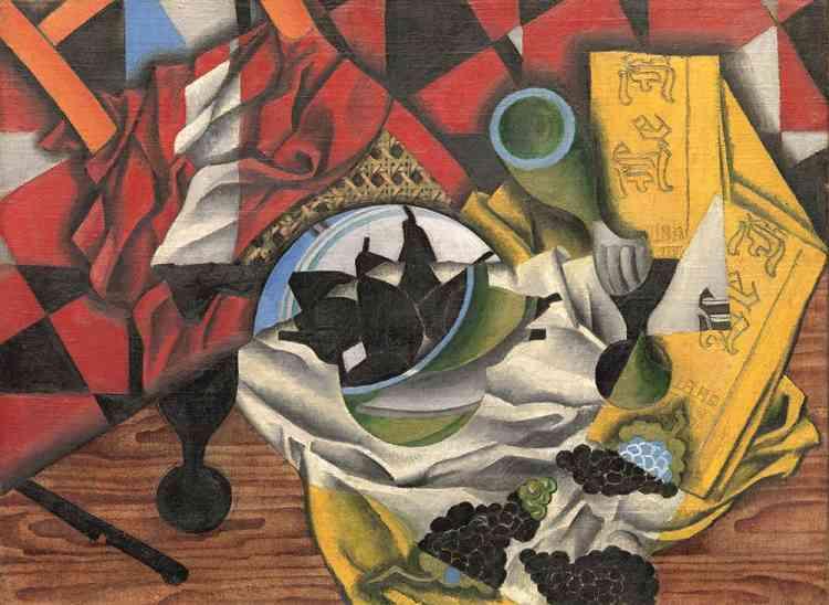 «Pendant les heureux mois de l'été 1913 passés à Céret, en partie avec Picasso, Juan Gris affirme son propre cubisme, conceptuel et coloré. Tout en reprenant des motifs typiquement cubistes (le verre, le journal, la chaise cannée, le faux bois de la table), ses natures mortes se distinguent par leur audacieuse polychromie et leurs compositions dynamiques, où les objets semblent se démultiplier par projection.»