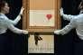 Après autodestruction, la toile « Girl with Balloon » de Banksy a été renommée« Love is in the Bin ».