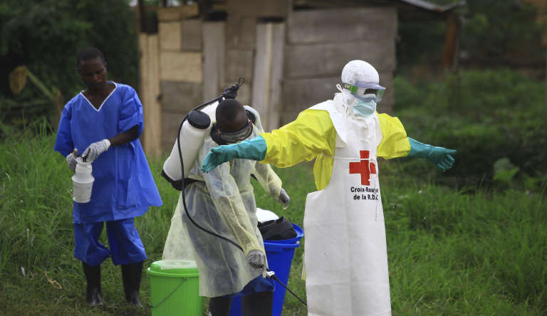 A healthcare member is disinfected when they leave Ebola treatment center in Beni, East Democratic Republic of Congo, in September 2018.