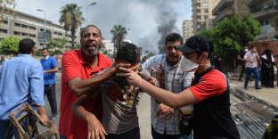 Affrontements entre des partisans de Mohamed Morsi et les forces de sécurité, au Caire, le 14 août 2013.