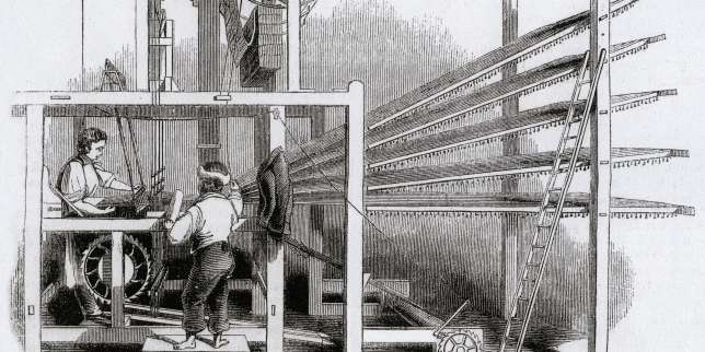 A weaver sits at a Brussels carpet loom at a Glasgow carpet factory. The pattern is created using Jacquard punched cards which travel across the top of the loom. (1843)