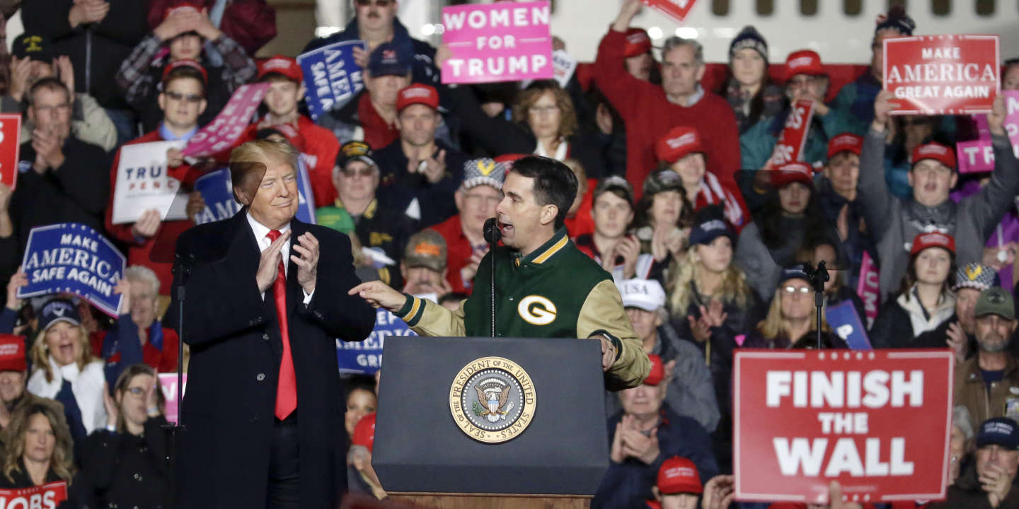 With President Donald Trump at his side Wisconsin Gov. Scott Walker speaks during a rally Wednesday, Oct. 24, 2018, in Mosinee, Wis. (AP Photo/Mike Roemer)