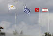 Cypriot and Greek flags along with Turkish and Turkish Cypriot are seen near the UN controlled buffer zone in Nicosia, Cyprus October 25, 2018. REUTERS/Yiannis Kourtoglou