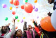 """Kids release balloons after a prayer for former South African President Nelson Mandela on July 5, 2013 outside the Medi Clinic Heart Hospital where Mandela is hospitalized in Pretoria. During a nearly one month battle for his life in hospital, ailing South African icon Nelson Mandela has occasionally been uncomfortable but has not been in pain, his wife Graca Machel said on July 4. Doctors treating Nelson Mandela said he was in a """"permanent vegetative state"""" and advised his family to turn off his life support machine, according to court documents dated June 26, obtained by AFP. AFP PHOTO / STEPHANE DE SAKUTIN (Photo by STEPHANE DE SAKUTIN / AFP)"""