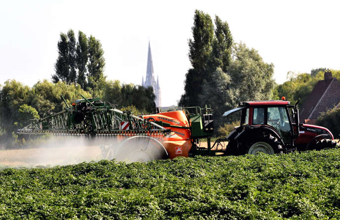 Application of pesticides in a field in Cassel, northern France, August 16, 2013.