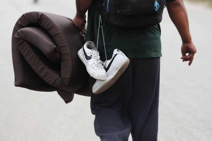 Un migrant d'Amérique centrale faisant partie de la caravane vers les Etats-Unis arrive dans l'Etat de Mexico, le 3 novembre.