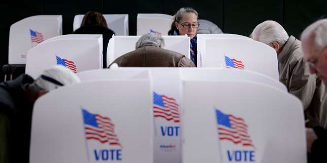 (FILES) In this file photo taken on October 25, 2018 People cast their ballots at a community center during early voting in Potomac, Maryland, two weeks ahead of the key US midterm polls. Immigration, health care, jobs. The extraordinary US midterm election has been a tug of war over key issues, but none has had a more dramatic impact on voters than Donald Trump, the man who isn't even on the ballot. Democrats hope voter dissatisfaction with the contentious commander in chief will lead to a blue wave that flips control of the US House out of Republican hands. Trump's minions are counting on enthusiasm about core issues to trigger strong conservative voter turnout that preserves their majorities in Congress.  / AFP / Brendan Smialowski