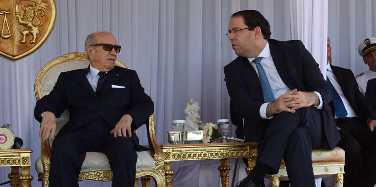 Tunisian President Beji Caid Essebsi (left) and Prime Minister Youssef Chahed in Tunisia on June 25, 2018.