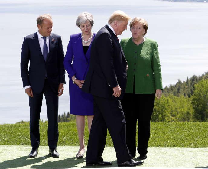 Donald Tusk, Theresa May, Donald Trump et Angela Merkel, lors du sommet du G7 de La Malbaie, au Quebec, le 8 juin.