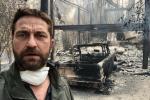 L'acteur Gerard Butler devant sa maison détruite par un incendie, en Californie, en novembre 2018.
