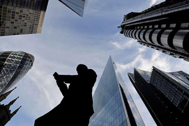 Dans la City, le quartier des affaires de Londres, le 13 novembre.