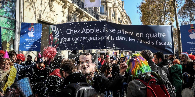 lemonde.fr - - Apple, paye tes impôts ! - : Attac manifeste contre l'ouverture d'un magasin à Paris
