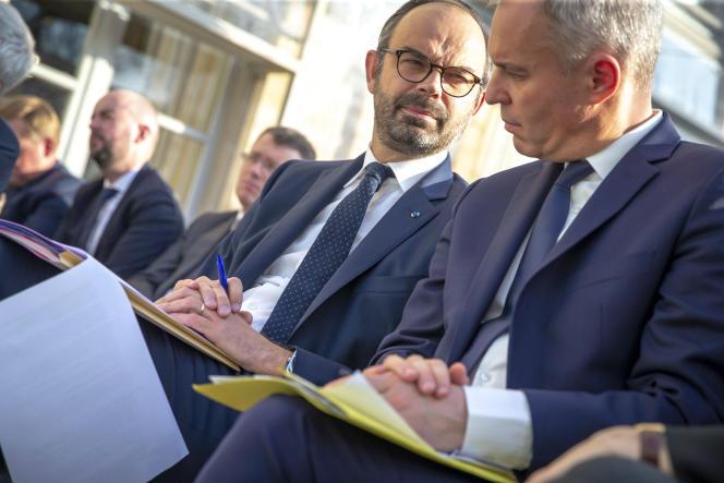 Edouard Philippe (à gauche) et François de Rugy assistent à un discours d'Emmanuel Macron, président de la République, au palais de l'Elysée à Paris, mardi27novembre2018.