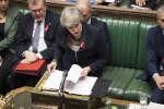 La première ministre britannique, Theresa May, défend son accord de Brexit à la Chambre des communes, 28 novembre 2018, Parlement britannique /Jessica Taylor via AP.
