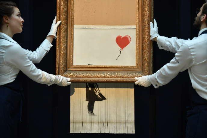 Love is in the Air une oeuvre de le Banskyvendue le 5 octobre 2018.