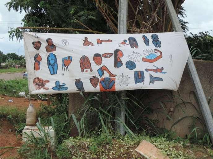 Publicité d'un guérisseur, à Yamoussoukro, en Côte d'Ivoire, en 2014.