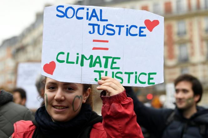 Pour les manifestants qui ont défilé à Paris, le 8 décembre,«Social, climat, même combat!».