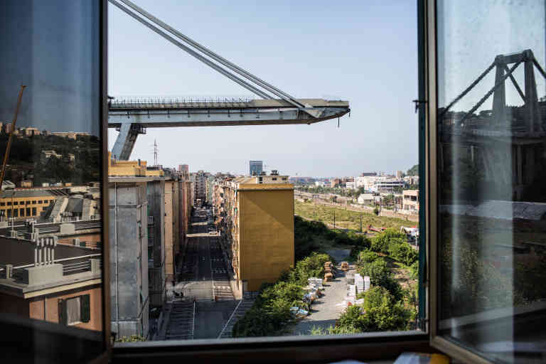 A view of the east side of the Morandi Bridge, which collapsed on Aug. 13, seen from a nearby apartment in Genoa, Italy, Aug. 24, 2018. The collapse of the bridge -- a signature of the port city, a source of deep civic pride, and an indispensable daily transportation link for thousands -- has scarred Genoa and set off a bitter debate in Italy about who bears responsibility for the disaster and what caused it. (Nadia Shira Cohen/The New York Times) --  PART OF A COLLECTION OF STAND-ALONE PHOTOS FOR USE AS DESIRED IN YEAREND STORIES AND RECAPS OF 2018 --  *** Local Caption *** EUROPE ITALY TRANSPORTATION RESCUE INJURIES GENOA KILLED COLLAPSE HIGHWAY GENOVA BRIDGE INFRASTRUCTURE FAIL YIR2018NEWS YIR2018 YEAREND
