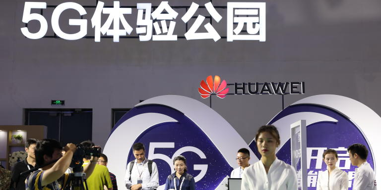 --FILE--People visit the stand of Huawei 5G during an exhibition in Beijing, China, 26 September 2018.